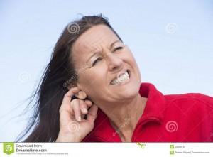 Woman scrathing her ears